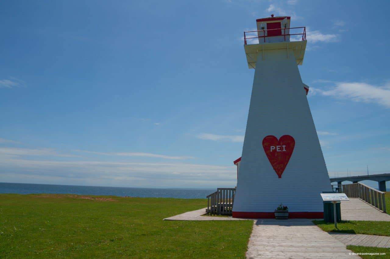 Confederation Bridge Light House Popular PEI Road Trip stops to the beaches of West Point