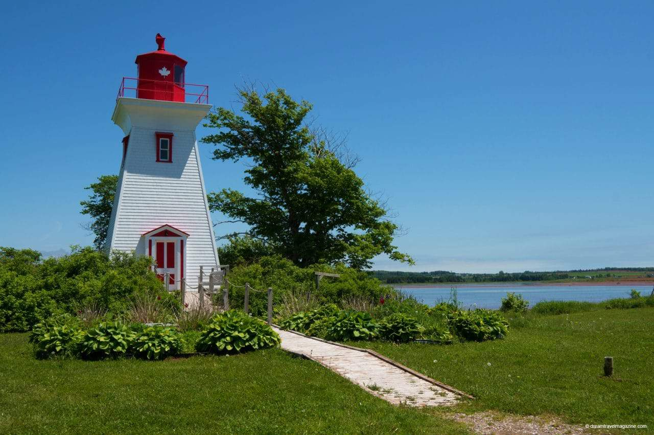 Victoria by the Sea lighthouse in PEI Popular PEI Road Trip stops to the beaches of West Point