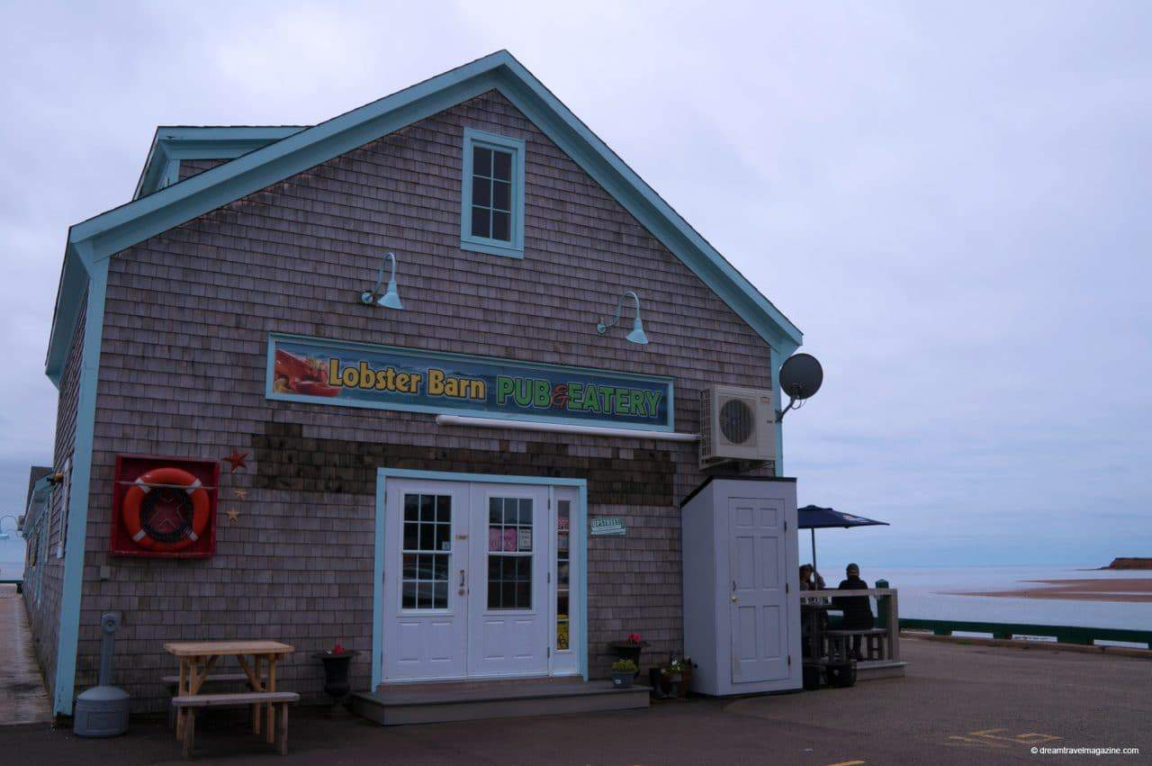 Lobster Barn building on pier in Victoria by the Sea Popular PEI Road Trip stops to the beaches of West Point